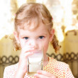 Girl drinks milk — Stock Photo #11532182