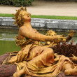Bronze statue in the park of Versailles Palace — Stock Photo