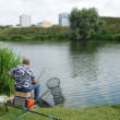 Stock Photo: France, fishermnear Sautour pond in Les Mureaux