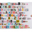 Royalty-Free Stock Photo: Hand holding newspaper clippings alphabet