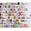 Stock Photo: Hand holding newspaper clippings alphabet