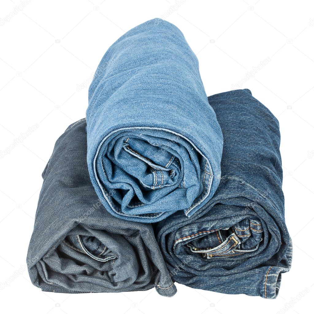 Stack of rolled jeans isolated on white background — Stock Photo #11654579