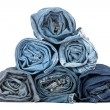 Stack of rolled jeans — Stock Photo