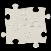 Gray cardboard jigsaw puzzle — Stock Photo