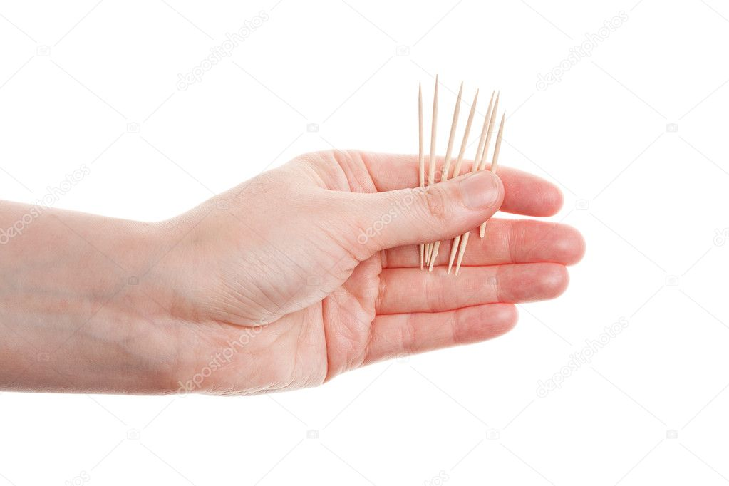 Toothpicks in hand isolated on white background — Stock Photo #12081241