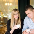 Attractive young couple enjoying beverage. — Stock Photo