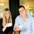 Cute young couple having coffee. — Stock Photo