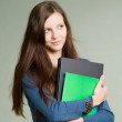Beautiful young student girl holding laptop. — Stock Photo