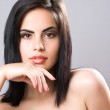 Pensive young brunette beauty — Stock Photo