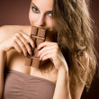 Chocolate loving brunette beauty — Stock Photo #11599369
