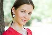 Closeup of young pretty brunette — Stock Photo