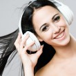 Stock Photo: Brunette beauty enjoying music.