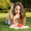 Beautiful brunette studying outdoors. — Stock Photo #11997535
