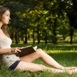 Gorgeous brunette reading a book in the park. — Stock Photo #12157981