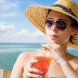 Young brunette with beach refreshment. — Stock Photo #12295539