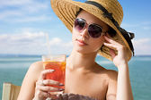 Cool young brunette on holiday. — Stock Photo