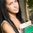 Gorgeous young brunette student girl outdoors. — Stock Photo