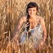 Woman in white dress in field with wheat - Stock Photo