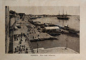 "ITALY - CIRCA 1910: A picture printed in Italy shows image of Venice Grand Canal with ships and gondola boats, Vintage postcards ""Italy"" series, circa 1910 — Stok fotoğraf"