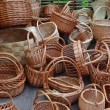 Stock Photo: A lot of vintage weave wicker baskets on a marketplace