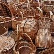 A lot of vintage weave wicker baskets on a marketplace - Stock Photo