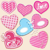 Scrapbook set of hearts in stitched textile style — Stock Vector