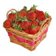 Appetizing strawberries in a basket. Isolated on a white background — Foto de Stock