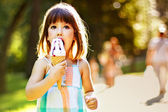 Girl eating ice cream — Stock Photo