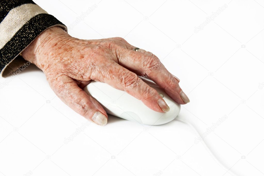 Elderly Hand on Computer Mouse on light plain background — Stock Photo #11112191