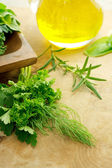 Herbs and olive oil — Stock Photo