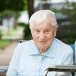 Happy senior lady in wheelchair — Stock Photo