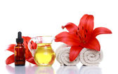 Spa Still Life - Essential Oils, Lilies and Towels — Стоковое фото