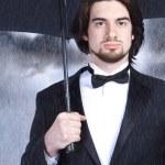 affärsman med paraply — Stockfoto