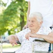Senior Women in Wheelchair with Caretaker — Foto Stock