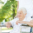 Senior Women in Wheelchair with Caretaker — Stock Photo