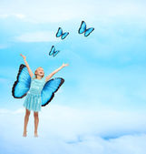 Happy Young Girl with Butterflies — Stock Photo