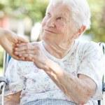 Senior Woman Holding Hands with Caretaker — Stock Photo