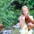 Blonde Girl in the Garden with Chickens — Stock Photo