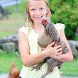Blonde Girl in the Garden with Chickens — Stockfoto