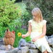 Blonde Girl in the Garden with Chickens — Стоковая фотография