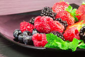 Greedy red fruits — Stock Photo