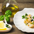 Grilled squis with lemon slice and oil — Stock Photo
