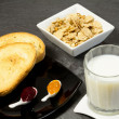 Stock Photo: Breakfast with milk,cereals and marmalade