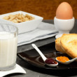 Milk glass with nutrient breakfast background — Photo
