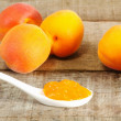 Apricot jam on spoon — Stock Photo