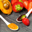 Stockfoto: Loquat and strawberry jam with fruits