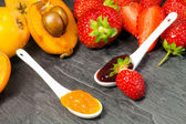 Loquat and strawberry jam with fruits — Stock fotografie