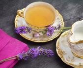 Lavender flavored tea with milk jug — Stock Photo