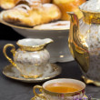 图库照片: Lavender flavored tewith teapot and sweets