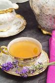 Tea break with lavender flavored tea — Stock Photo